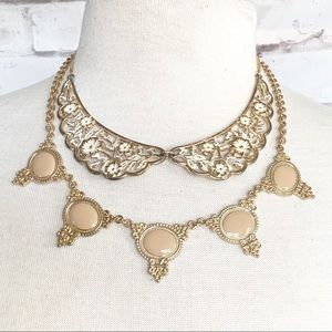 Double up on Statement necklaces